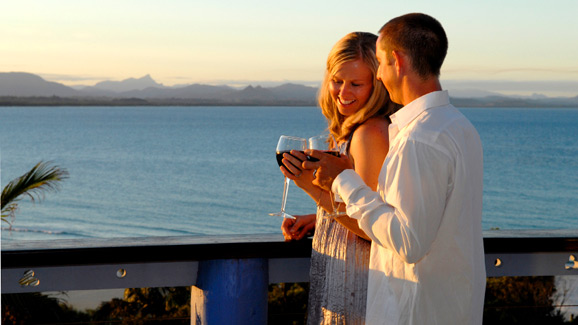Couple Drinking Wine Overlooking the Ocean