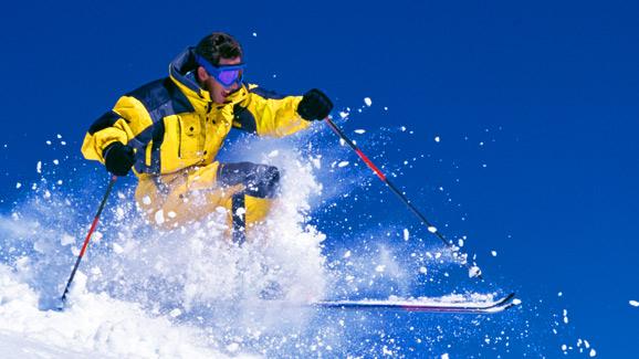 Skier in Yellow Onesie