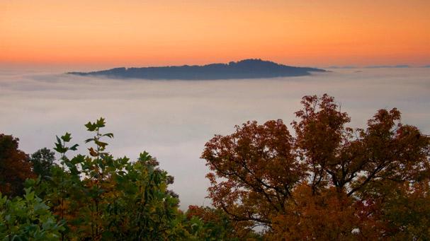 mountain peak out of fog blue ridge parkway
