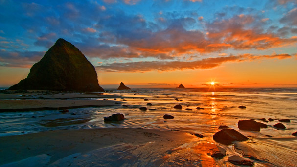 sunset at arch cape oregon