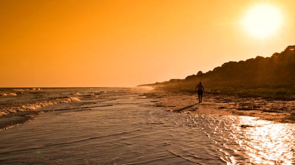 sunset walk along the beach in hilton head